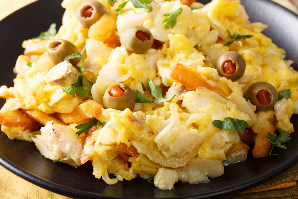 Bacalhau à brás,  fried shredded cod with french fries, onions and eggs. Photo: Shutterstock