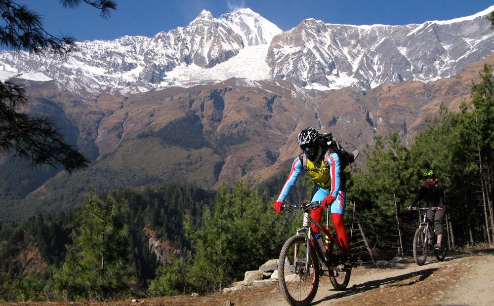Biking benath Dhaulagiri. Photo: Nepal trip provider
