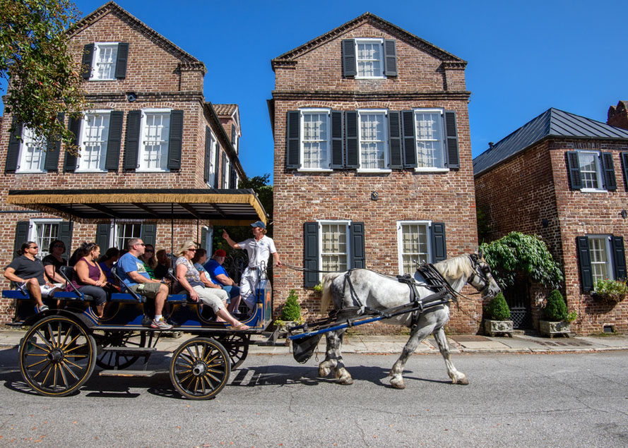 Horse carriage with tourists enjoying facades of Societe Francaise in Charleston, SC. Photo: Shutterstock