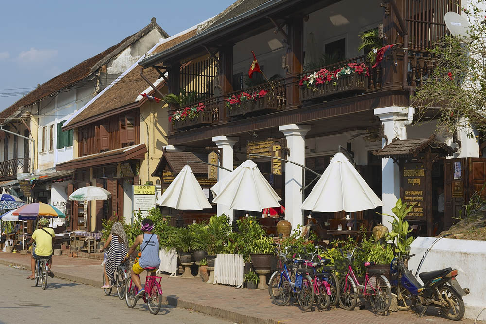 Riding bicycles through in Luang Prabang. Photo: Shutterstock