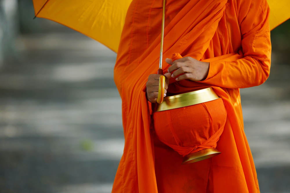 Collecting alms. Photo: Shutterstock