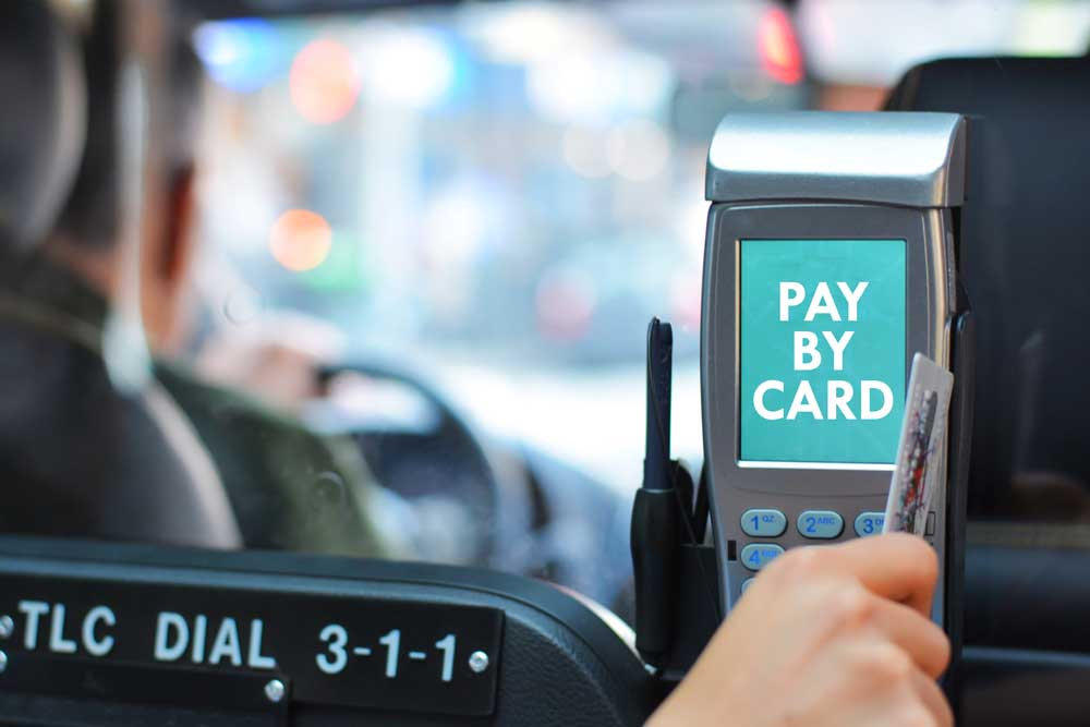 Paying taxi ride by card. Photo: Shutterstock