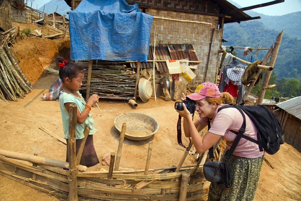 Taking photos of local children in Laos.