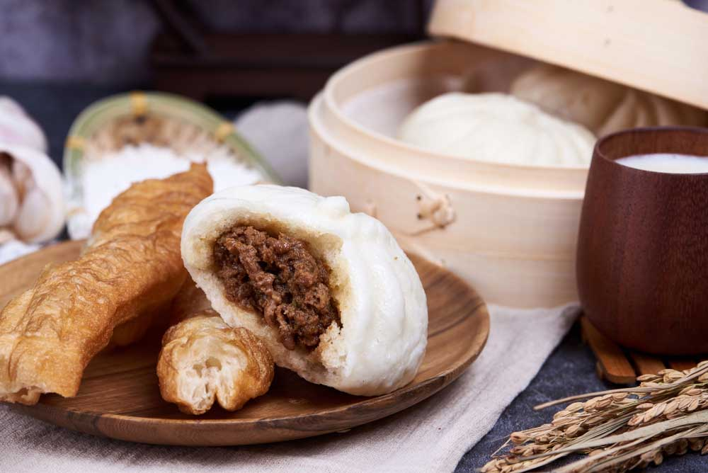 Steamed buns (Baozi) and fried breadsticks (youtiao) with soy milk. Photo: Shutterstock