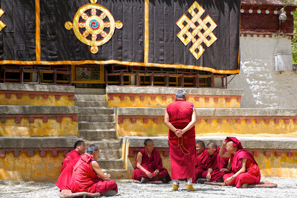 Monks debate at Sera monastery area in Lhasa, Tibet. Photo: Shutterstock
