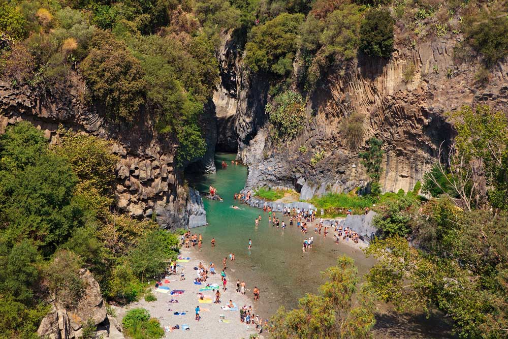 People enjoy ice-cold water of Alcantara river. Photo: Shutterstock