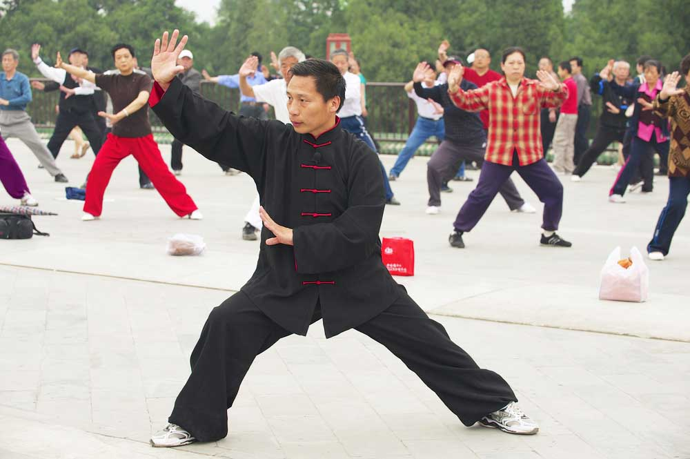 Practicing tai chi chuan gymnastics in Beijing. Photo: Shutterstock