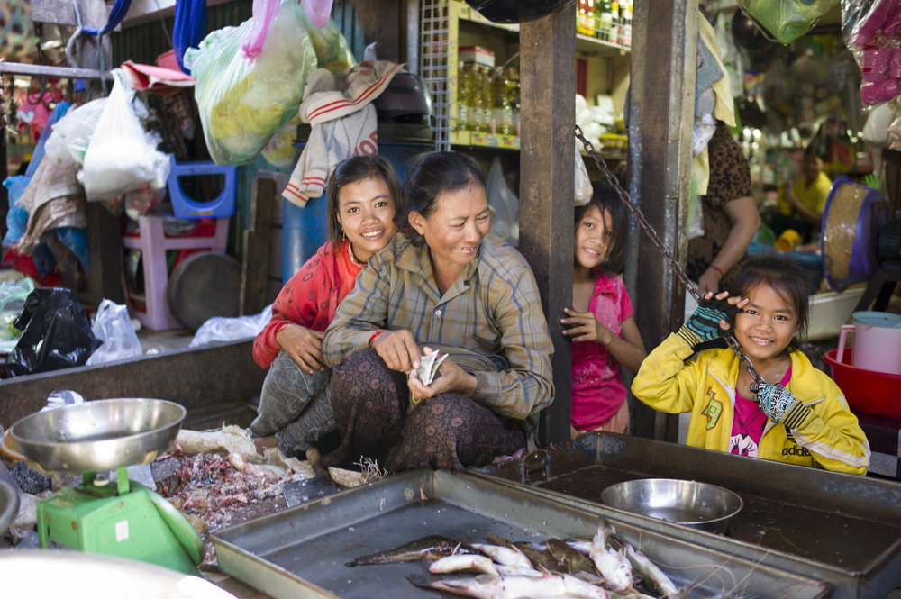 A fish seller and her family at Toul Tom Poung Market, Phnom Penh. Photo: gary yim/Shutterstock