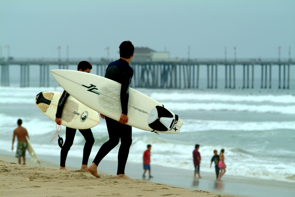 Surfers on Huntington Beach. Photo: Marc Pagani Photography/Shutterstock