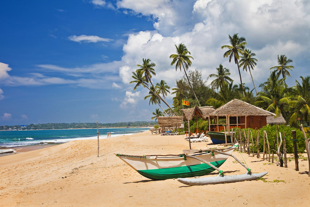 Beach scene with boat in Sri lanka. Photo: Shutterstock