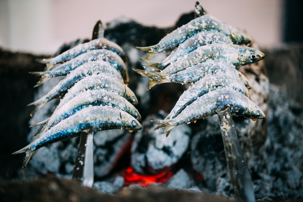 Sardines grilled over an open fire on the beach are a must-try while you're in Málaga.