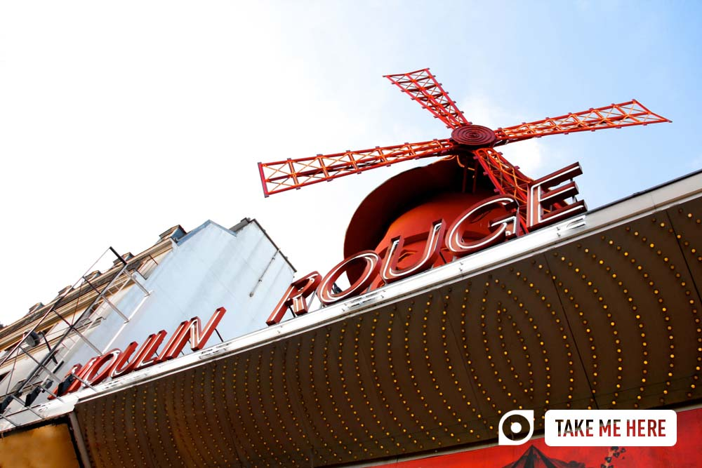 Iconic windmill on top of the Moulin Rouge in Paris.