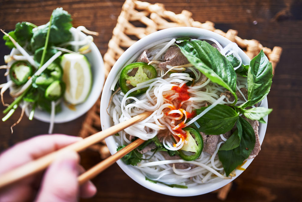 Vietnamese pho with spicy sriracha sauce.