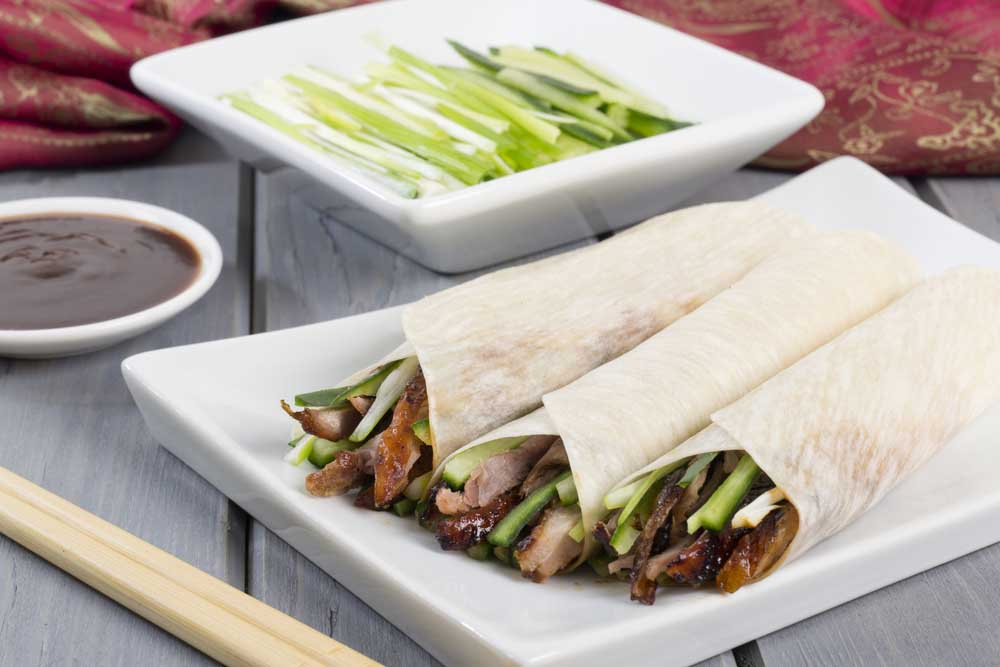 A firm favourite is Peking Duck: duck served with cucumber, spring onion and hoisin sauce, wrapped in pancakes.