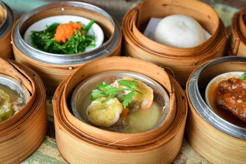 Dim sum in a typical bamboo steamer: a must-try food experience during your time in Hong Kong.
