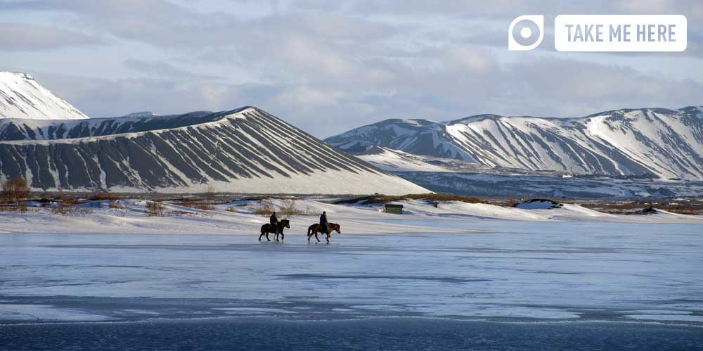 Horse riding on a frozen Lake Mývatn, Iceland.