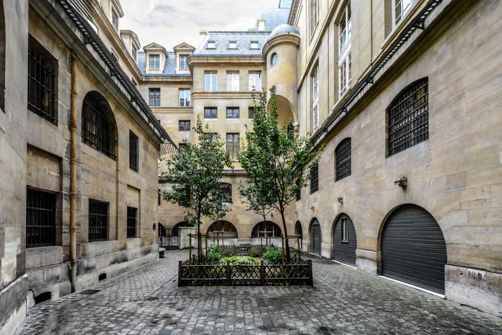 The garden courtyard in the former prison which held Marie Antoinette, the Conciergerie, in Paris.