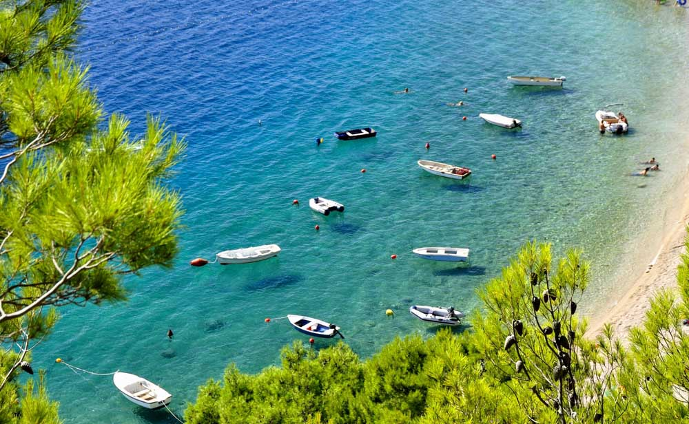 Clear sea with boats near the beach Lovrečina Bay, Brač Island. Photo: Shutterstock
