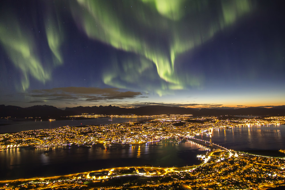 The world's best half marathons – Northern lights (aurora borealis) over Tromsø, potentially visible during the PolarNight Half Marathon.
