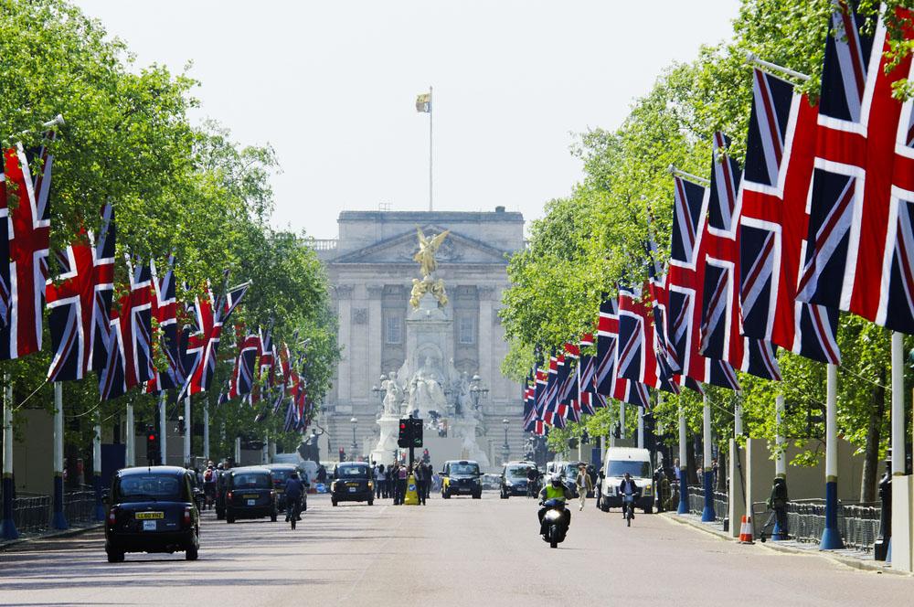 Union Jacks, black cabs, Buckingham Palace – iconic London. Photo: Shutterstock