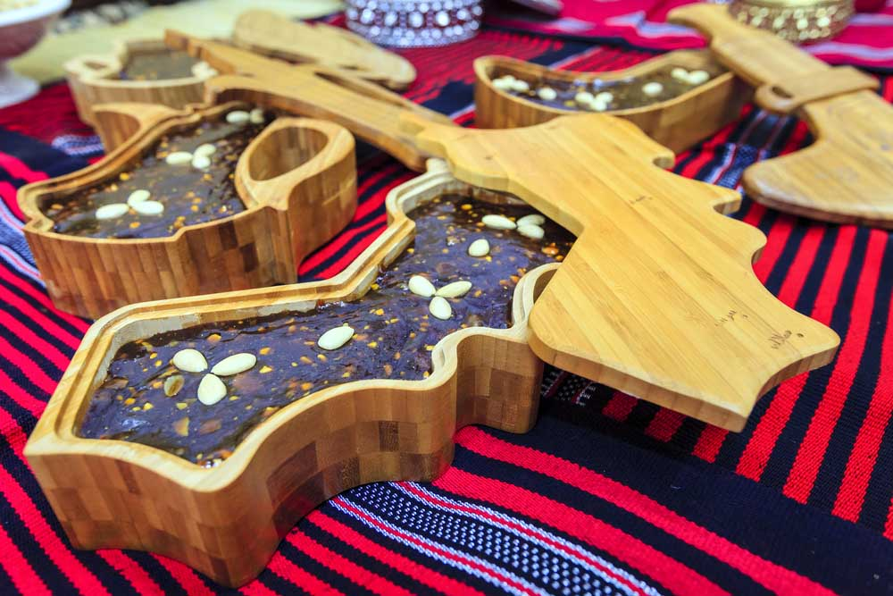 Freshly made Omani halwa - a traditional dessert in decorative wooden boxes. Photo: Shutterstock