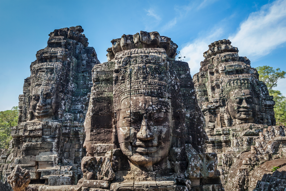 Ancient stone faces of Bayon temple. Photo: f9photos/Shutterstock