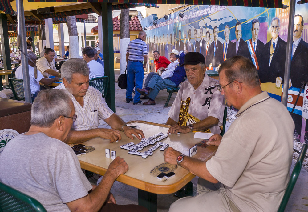 Elderly Cuban men play dominoes at Gomez Park in Miami. Photo: Shutterstock