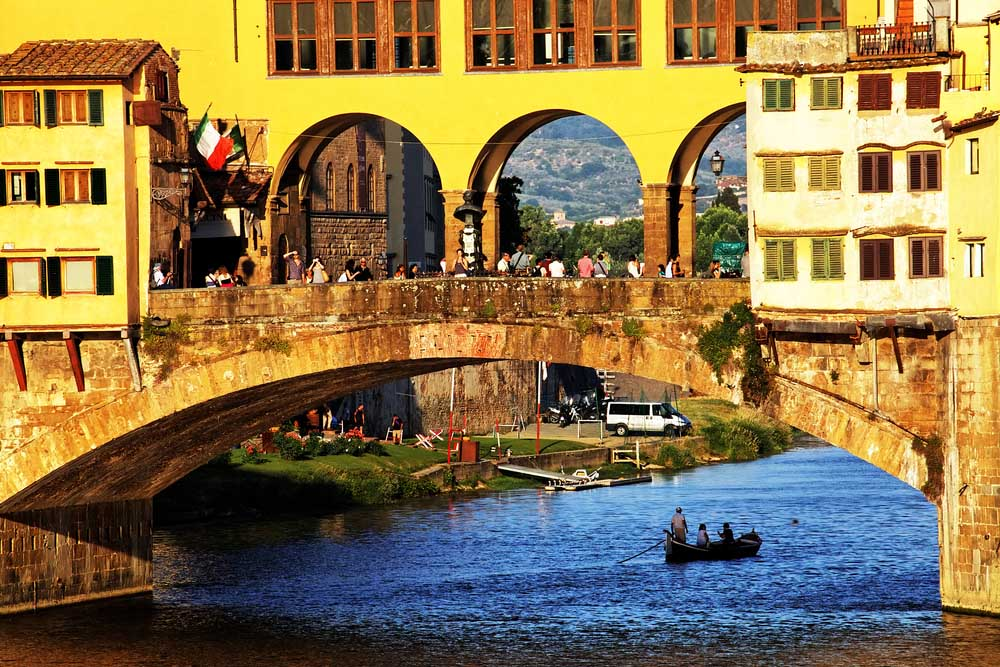 Sunset light over Ponte Vecchio, Arno River, Florence.