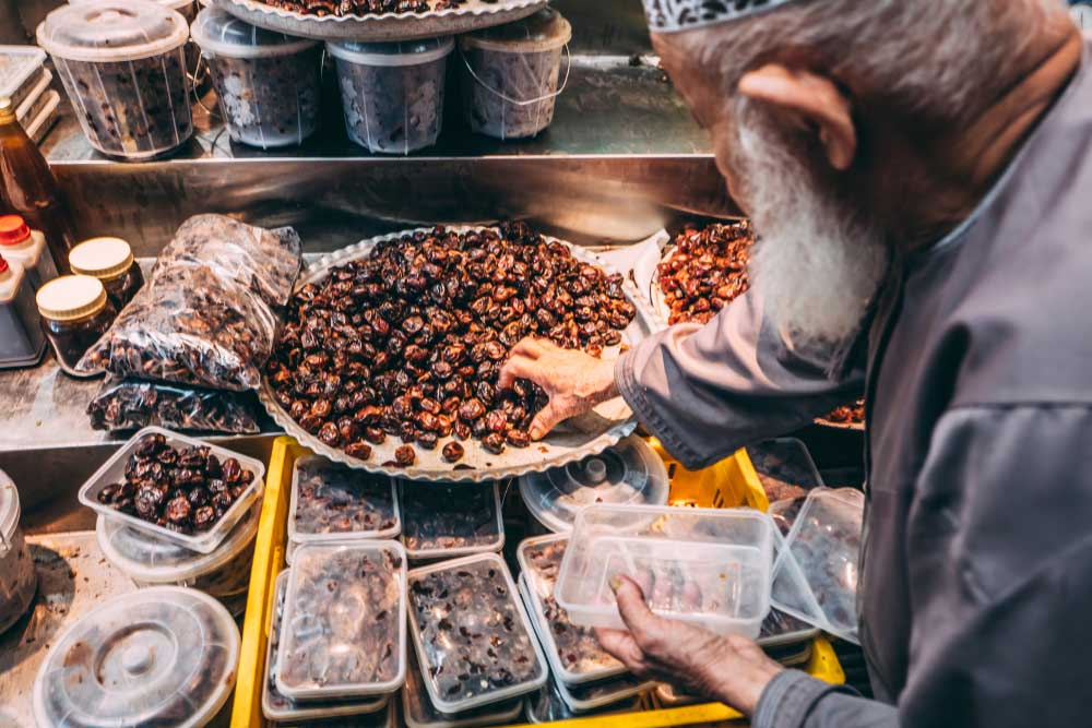 Selling fresh date fruits at the local market in Muscat. Photo: Shutterstock
