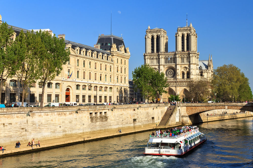 Cruising past the Notre-Dame Cathedral in Paris. Photo: Shutterstock
