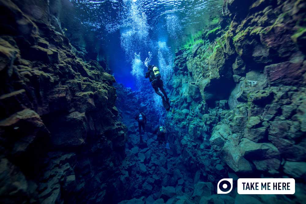 Diving in the crystal-clear waters of Silfra, Iceland