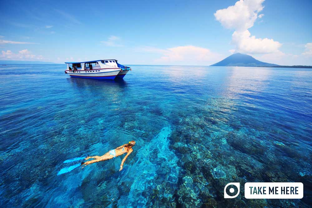 Snorkelling in shallow waters at Bunaken Islands, Indonesia