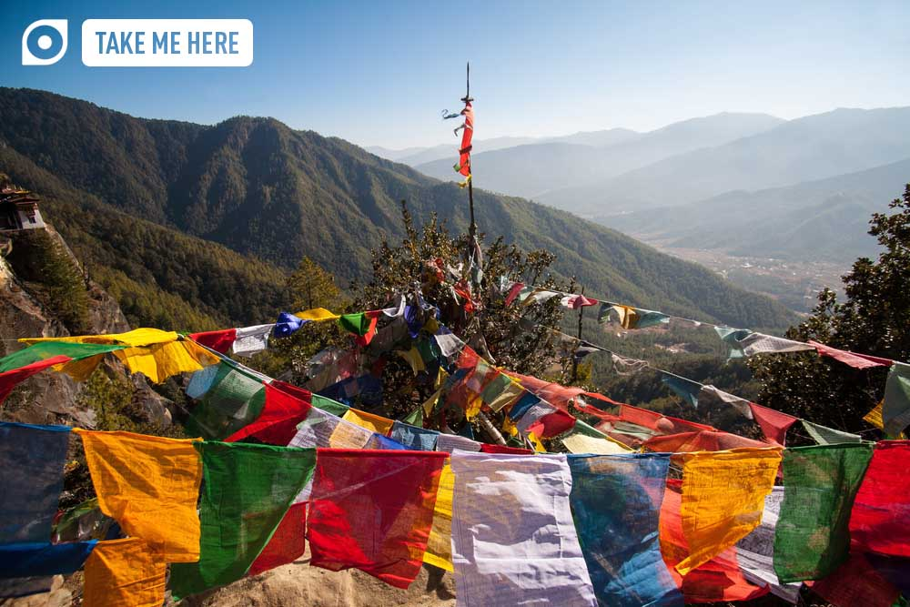 Buddhism prayer flags on a trekking path in Bhutan.