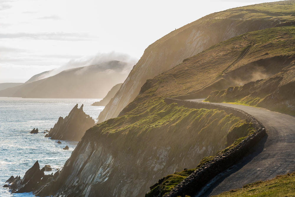 Narrow Irish coastal road just above the steep and dangerous cliffs. Photo: Shutterstock