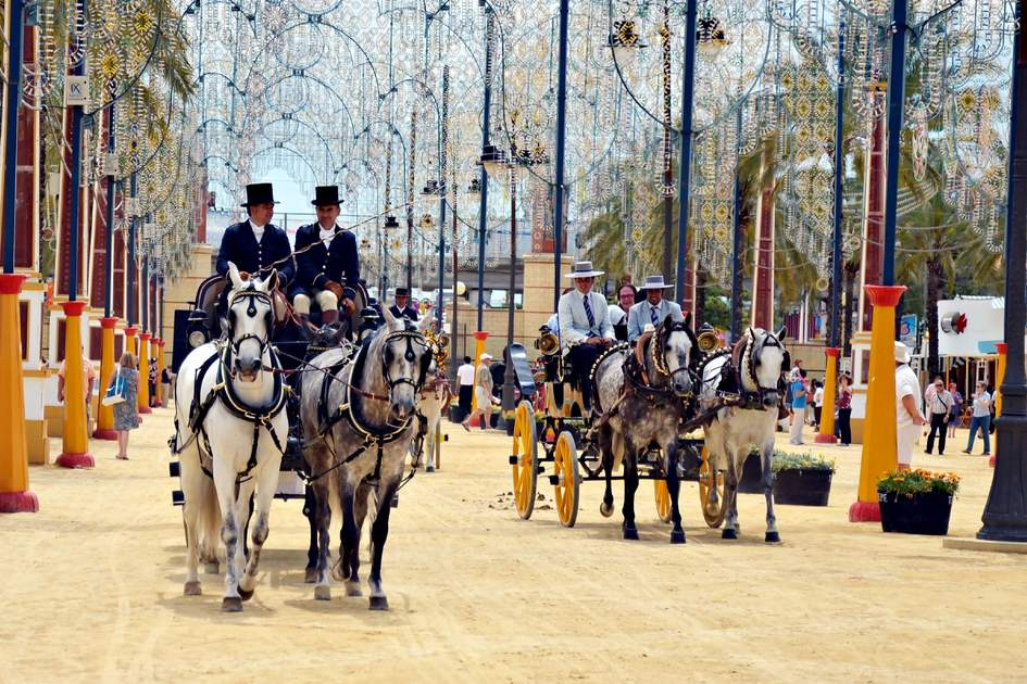 JEREZ DE LA FRONTERA, SPAIN-MAY 12: People in carriage horses walking in the royal house of the fair on the horse fair the day May 12, 2012 in Jerez de la Frontera, Spain.