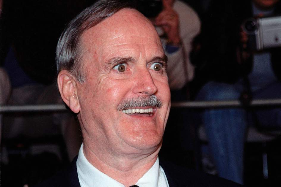 "Actor JOHN CLEESE at world premiere, in Los Angeles, of the new James Bond movie ""The World Is Not Enough"" in which he plays ""R"". Paul Smith / Featureflash"