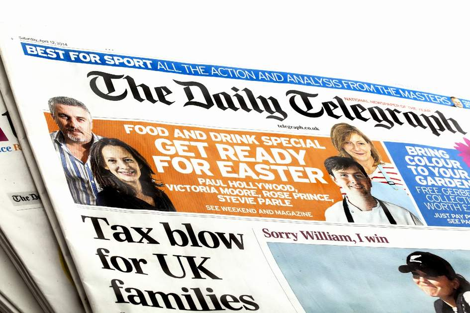 SWINDON, UK - APRIL 15, 2014: The Daily Telegraph News Paper on a white background