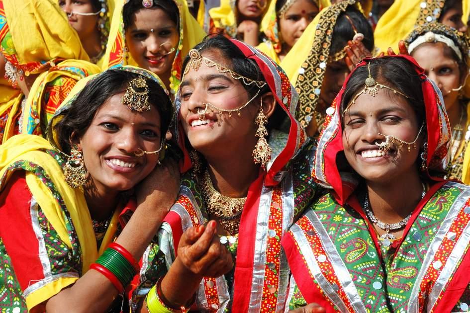PUSHKAR, INDIA - NOVEMBER 21: Unidentified indian girls are preparing to dance at annual Thar desert camel fair in Pushkar on November 21,2012 in Pushkar,Rajastan,India