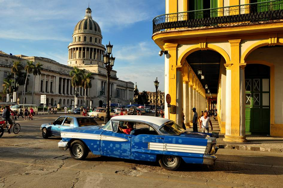 HAVANA, CUBA - DECEMBER 15 2014: Cubans walking normally in the center of Havana, after the US announced changes to its policy with Cuba