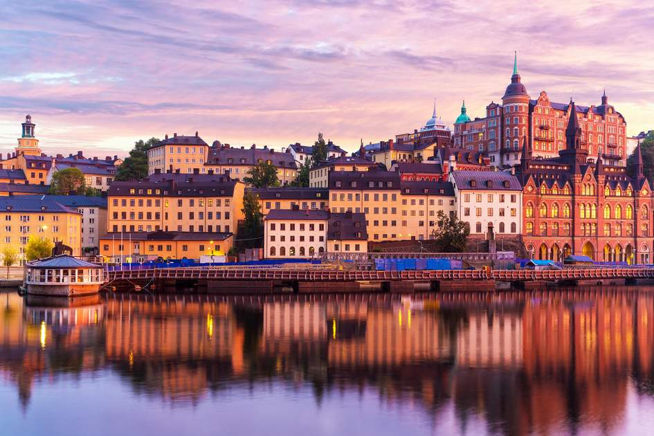 Beautiful evening sunset scenery of Sodermalm district near Slussen and the Old Town (Gamla Stan) in Stockholm, Sweden