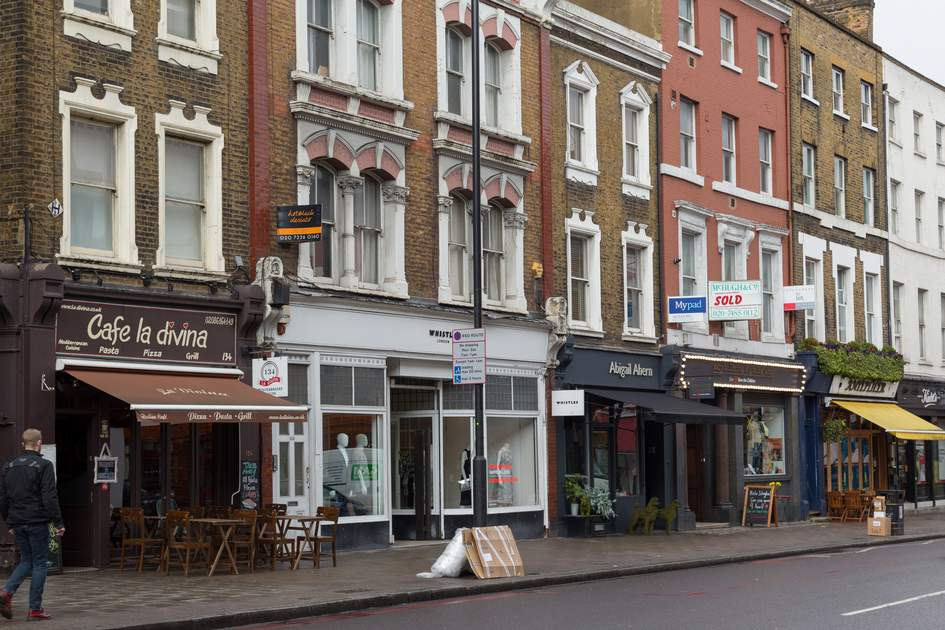 LONDON, UK - 26TH MARCH 2015: A view of various restaurants and businesses along Upper Street in Islington, london. People can be seen.