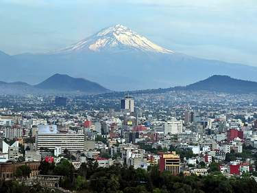 Popocatepetl volcano mountain raise above Mexico city