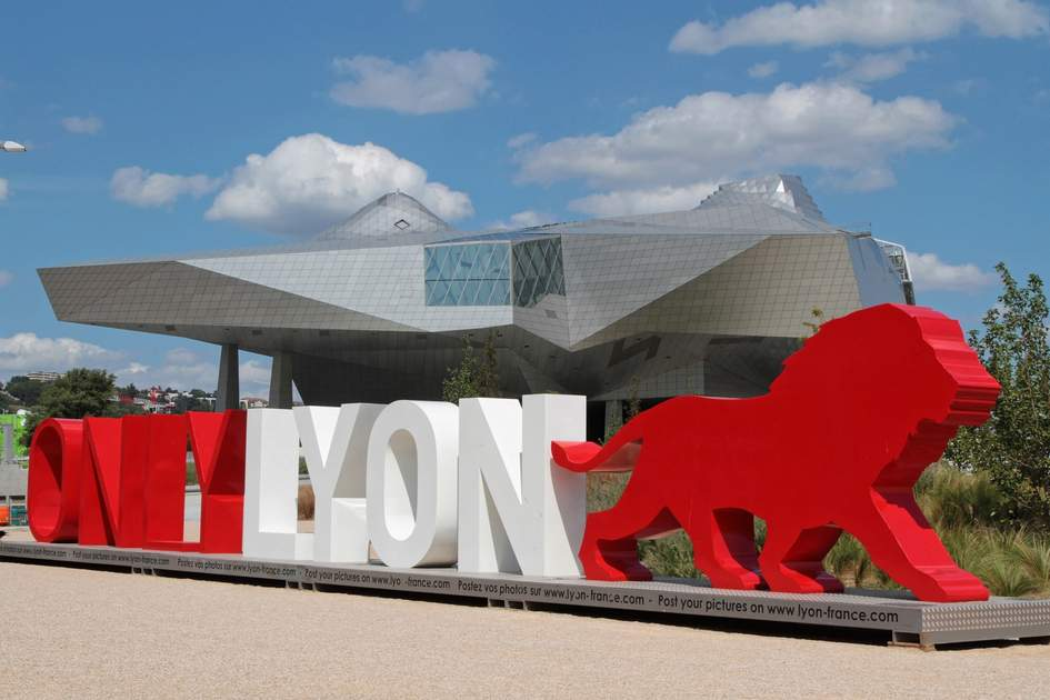 """OnlyLyon, the city branding word in front of the """"Musee des Confluences"""", a science and anthropology museum at the confluence of Rhone and the Saone rivers."""