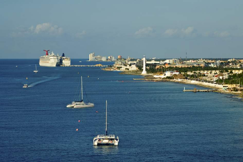 Cruise ship and catamaran sail boats in port of Cozumel Mexico Yucatan Peninsula