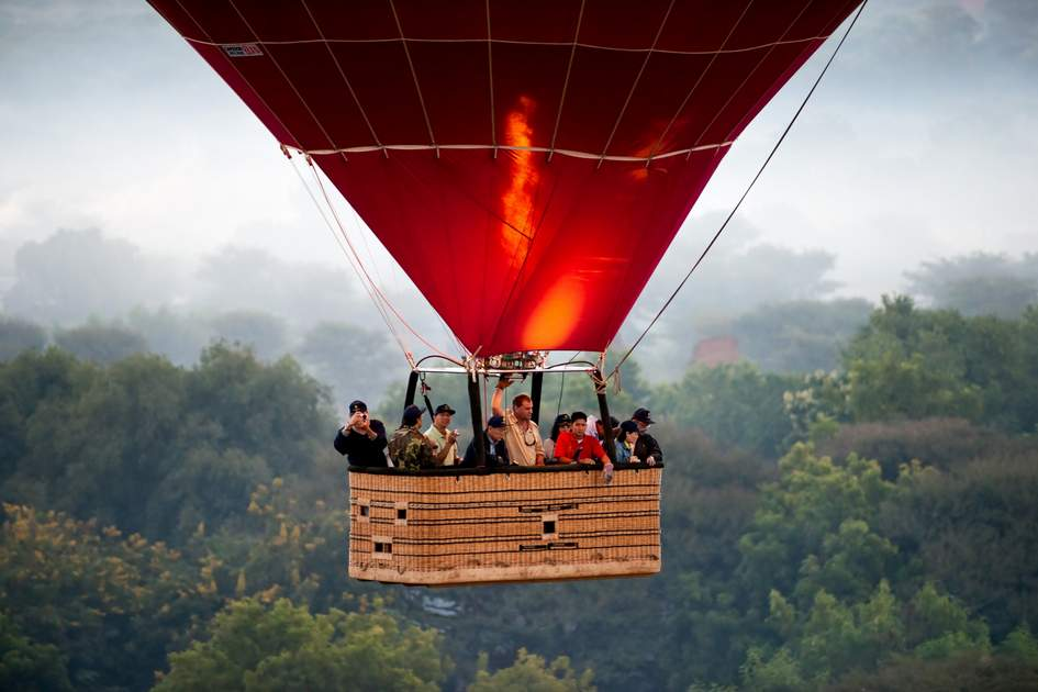 Tourist in an Hot Air Balloon over the plain of Bagan