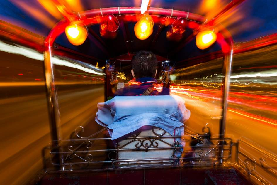 Dynamic perspective and long time exposure inside a Tuk tuk vehicle in Bangkok, Thailand
