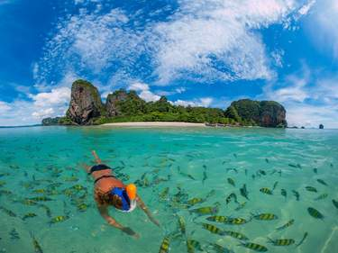 Woman snorkling in Poda Beach in Krabi Thailand