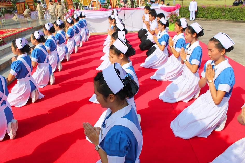 Nurses are lining up for salute King Chulalongkorn statue in front of provincial hall in Mahasarakham, Thailand.