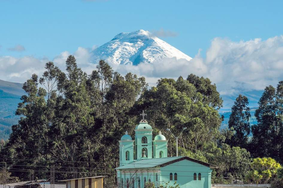 Volcanoes in Ecuador: Cotopaxi volcano over the San Jaloma Church and Village, De Los Chillos Valley.