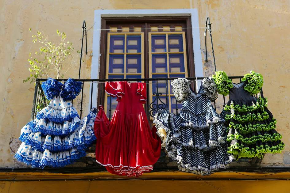 Traditional flamenco dresses at a house in Malaga, Andalusia, Spain. Photo: jorisvo/Shutterstock